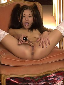 Asian in uniform puts dildo in her tight cunt