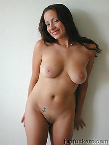 Brunette Butter shows off big breasts