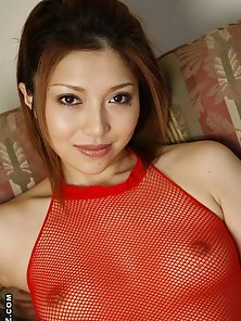 Sweet Japanese hottie Aki Anzai is posing in fishnet lingerie