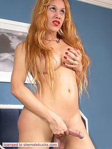 Red lipped busty transsexual showing her red nylons