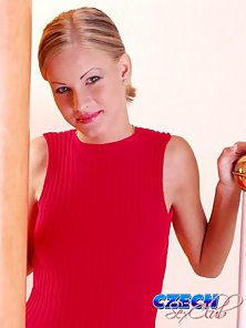 Provocative Czech blondie stripping her red t-shirt and showing her perky boobies