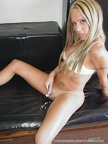 Delicious blonde shemale Sol fingering her ass on the couch