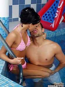 Petite brunette slut sucking and riding a fat prick at the poolside