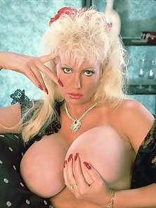 Adorable Blonde in White Stockings with Mega Huge Boobs Get Naked