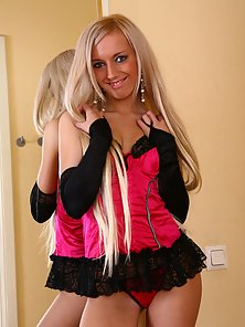 Sexy blonde babe flashing tits and pussy in stockings