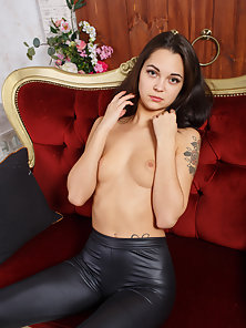 Wonderful Brunette Teen Takes Her Top Off to Reveal Her Boobs