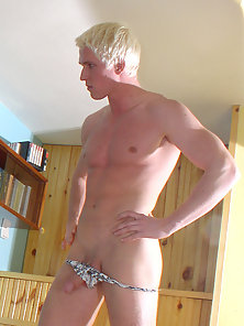 Jerking his blond twink cock
