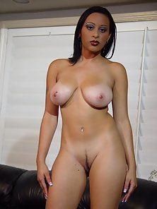 Big natural ebony babe strips dress by the couch
