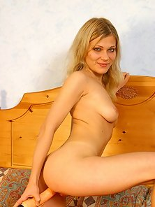 First-timer Emily strips naked, spreads and deflorates herself with a smooth dildo.