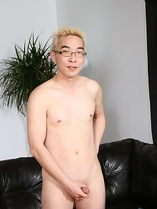 Asian blonde gay in glasses Eddie stripping and wanking his hard pecker on the couch