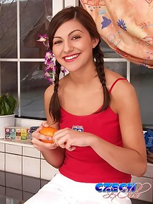 Pig-tailed brunette Czech cutie stripping and fingering her twat in the kitchen