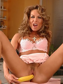 Curly mature Jessica showing her pink twat in the kitchen