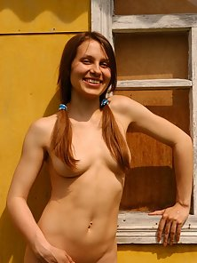 Teeny with ponytails posing naked