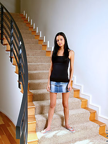 Naughty girl marissa proudly flaunting her shaved pussy on the stairways