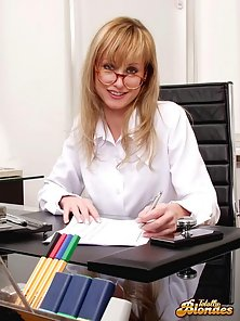 Luscious blonde secretary stripping and showing her sexy assets in the office