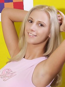 Busty blonde undressing and spreading wide showing pink pussy