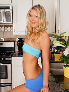 Pretty Anilos blonde in socks strips and spreads her pussy on top of kitchen sink