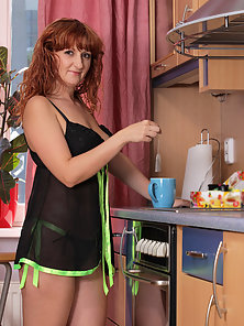 Naughty housewife spreads her mature pussy in the kitchen