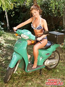 Cutie redheaded babe stripping lascivious on a motor bike