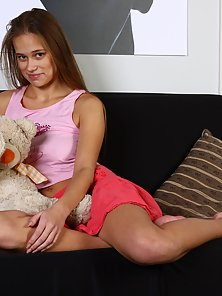 Sweet babe reveals her lovely pussy on the couch
