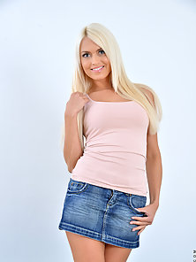 Blonde Teen Lower Her Skirt and Expose Her Pink Panty