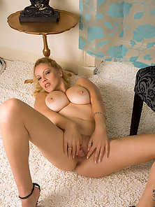 Mesmerizing Anilos with big tits sensually explores her mature pussy with her fingers