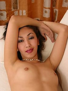Teeny spreads and plays with smooth dildo