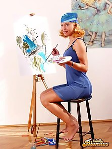 Delectable blonde cutie painting her young body