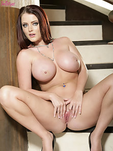 Sophie Dee spreads it at the stairs.