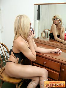 Glamorous blonde shemale showing her big cock