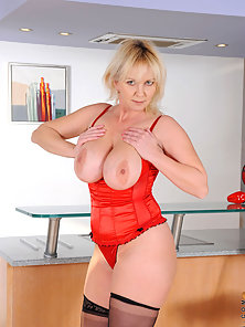 Blonde cougar Kimi flaunts her big tits and plays with her pussy using her fingers