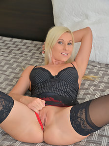 Stunning blonde milf teases and shows off her body before massaging her hungry wet twat