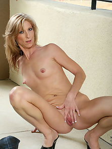 Attractive mature woman spreads her petite pussy lips displaying her mouth watering pink