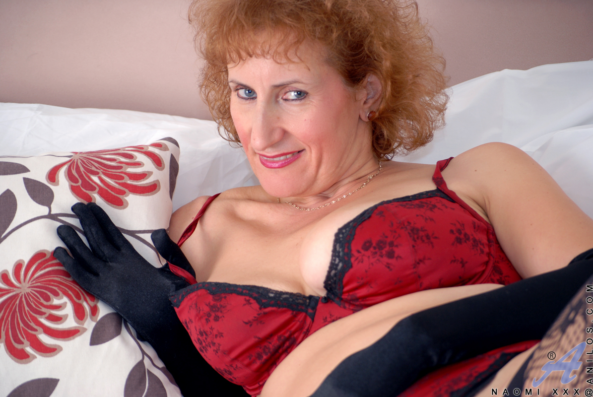 curly redhead milf posing in her sexy devil red lingerie - movie shark
