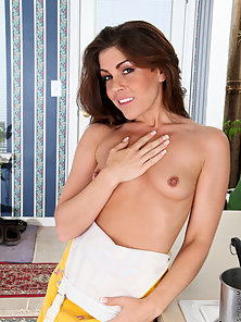 Brunette babe teases her big nipples and hairy pussy with kitchen utensils