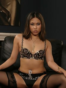 A petite Asian babe bouncing on a big white dick
