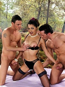 Sexy brunette is double penetrated by two huge cocks