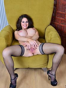 Black Stockings Wearing Babe on Couch Shows Her Big Boobs Squeezing