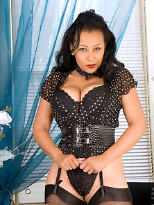 Donna in business attire teases us with her alluring milf beauty on cam