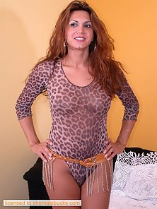 Ravishing redhead transsexual shows her respectable ass