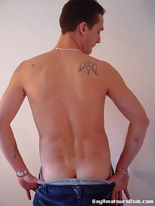 Tattooed gay Danny Black showing his perfect butt