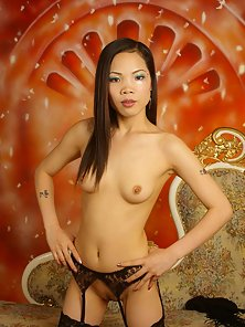Long haired asian beauty showing her hot body