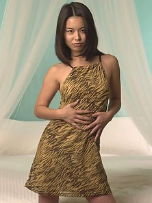 Long haired asian babe showing her horny body