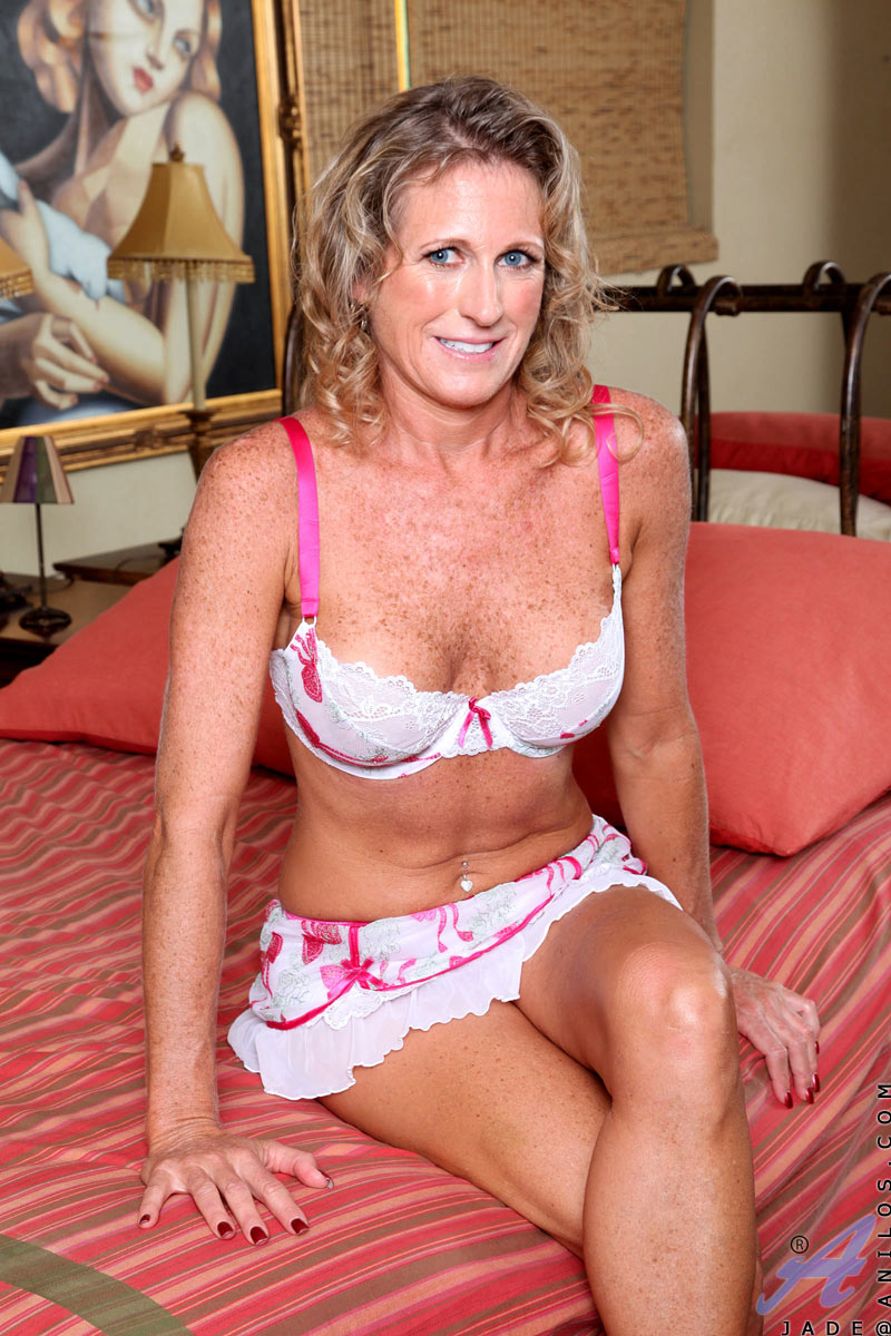 Sexy Mature Lady Flirtatiously Shows Off Her Big Tits As -8855