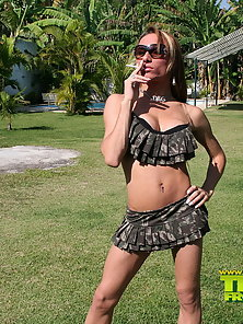 Smoking tranny posing outdoor and fucking a guy