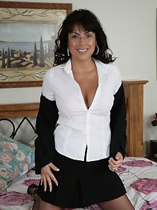 Sexy tanned older brunette with glasses looking very fine