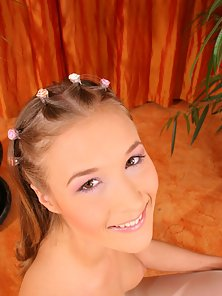 Innocent teenie brunette receives a spunk load on her face
