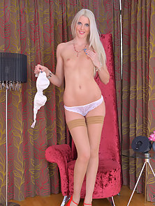 Gorgeous milf looks ravishing in her red heels as she plays with her bald twat