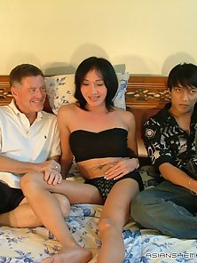 Beautiful Asian shemale touching her perky boobies with lust