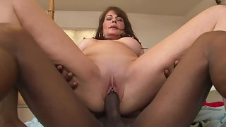 Round Ass Mature Gives Footjob to Her Black Dude